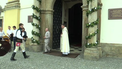 OLOMOUC, CZECH REPUBLIC, APRIL 15, 2018: Crowd pilgrimage of people cross way in the traditional folk costume of Hana, celebrations holidays in Olomouc on the Svaty Kopecek church, people happy