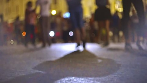 Defocused couples on background dancing salsa in the street