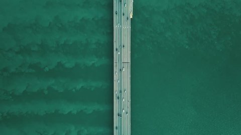 Aerial Top View of a Highway Bridge Flying Towards Traffic Over Sea Ocean in Penang Malaysia