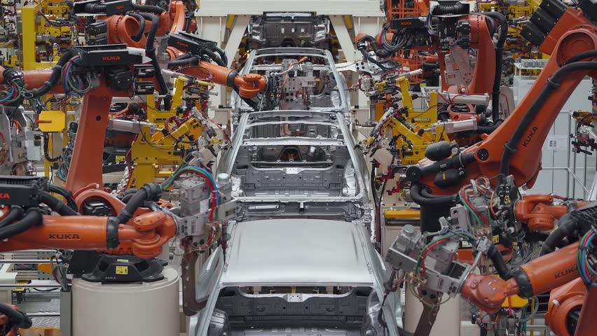 BELARUS, BORISOV - OCTOBER 19, 2017: Automobile plant, modern production of cars, car body welding process, robots, automated production line.