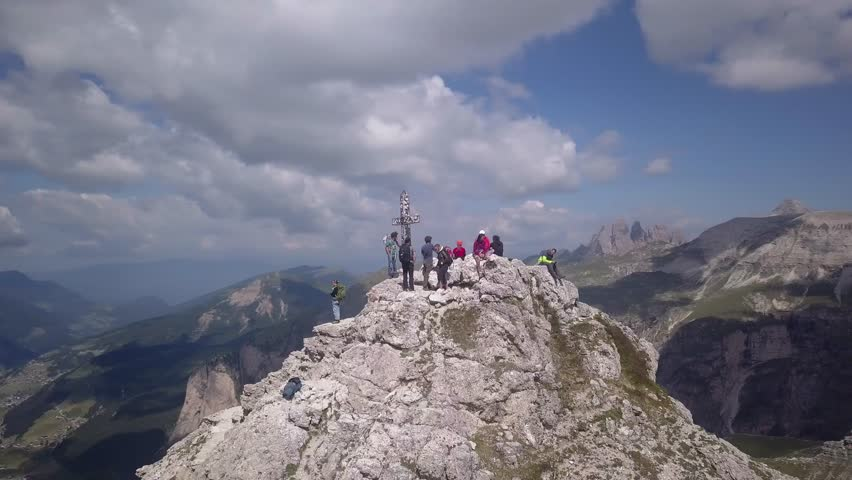 Drone orbiting around Gran Cir peak in the italien dolomites in summertime july. People sit at the peak. Nice summer colours. Middle of the day. | Shutterstock HD Video #1024422662