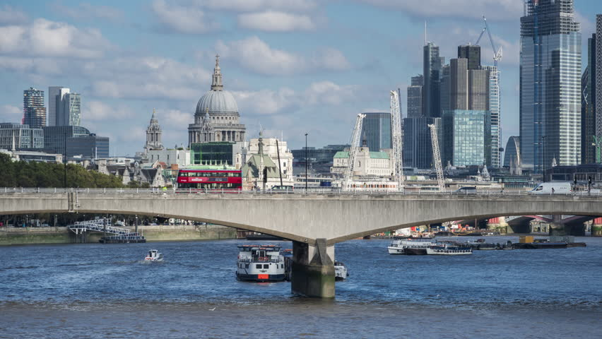Skyscrapers of The City of London, St.Paul's cathedral, car traffic on Waterloo Bridge, sunny day. Time lapse. London, UK. | Shutterstock HD Video #1024635332