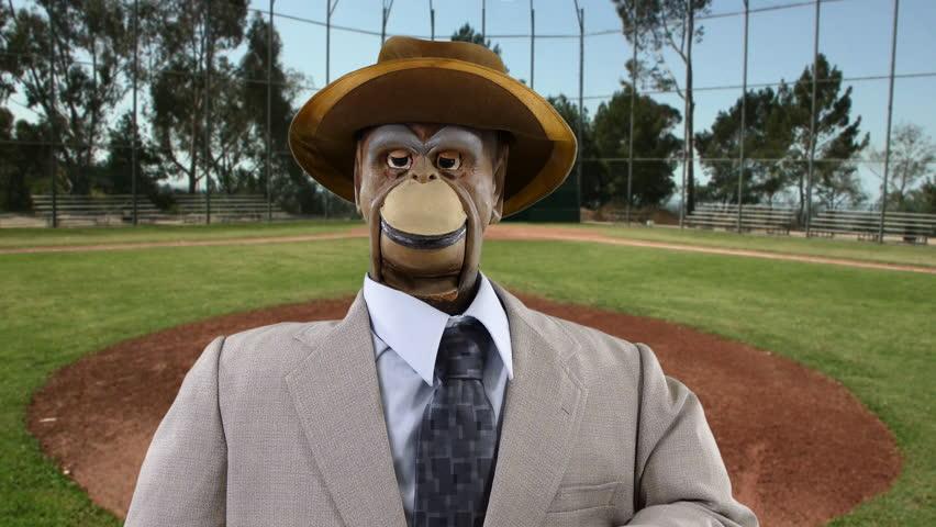 Vintage puppet monkey wants to play baseball.