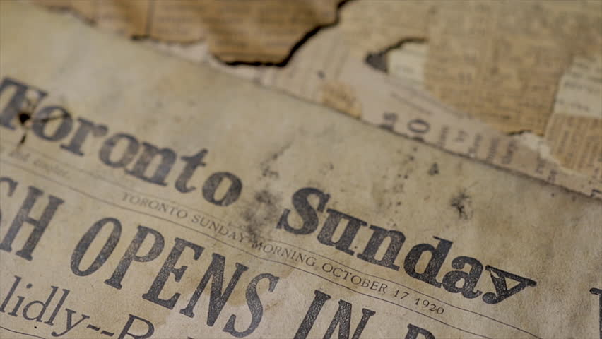 Toronto, Canada 2019:Close up of 1920's newspaper regarding World War I headline news. Old black and white printed documents. Vintage newspaper articles.