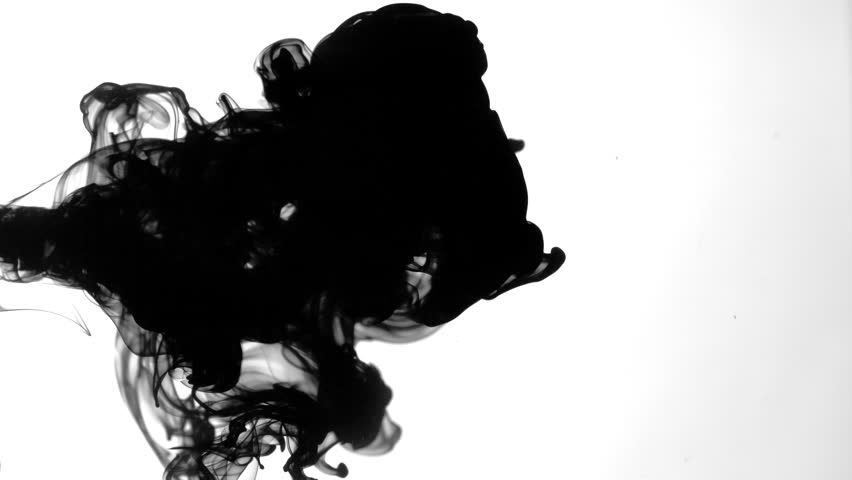Black ink flowing in water on white background