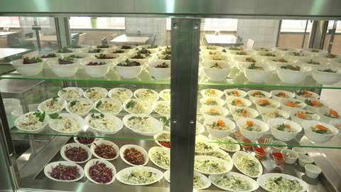 close-up, showcase with salads in modern canteen, cafeteria, dining room resturant, restaurant of public catering. salads with cabbage and corn for buffet catering In mess hall, Food Buffet resturant