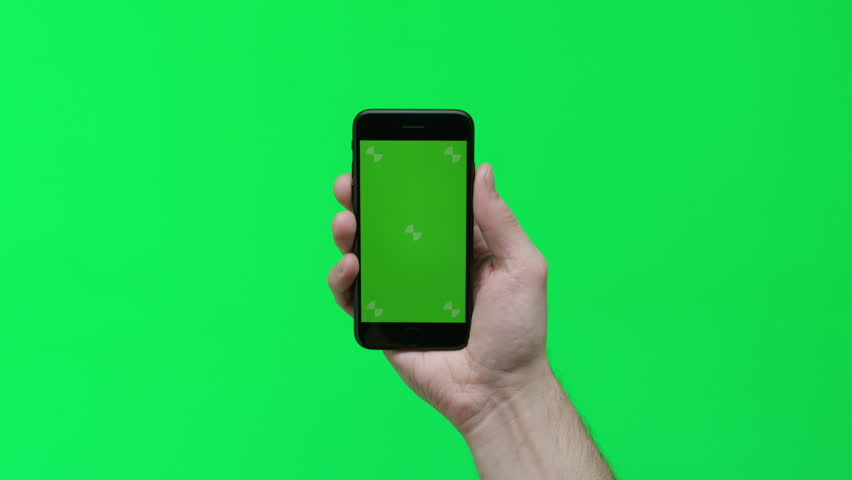 Male hand holding smart device on green screen chroma background making gestures, zoom in, pinch, swipe, scroll | Shutterstock HD Video #1024737662