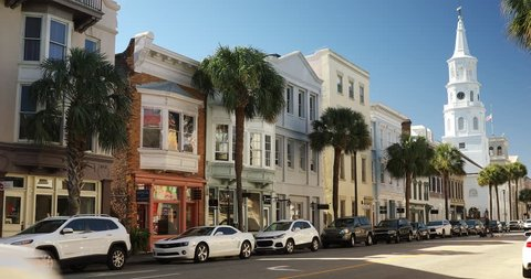Charleston, South Carolina, USA – October 24, 2018: Row of old historic downtown business buildings and Saint Michael's Church on Broad and Meeting streets in Charleston South Carolina USA