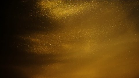 Golden sand or dust creating abstract cloud formations. Art backgrounds.