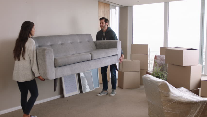Young couple moving house new home owners smiling enjoying successful move hugging in apartment | Shutterstock HD Video #1024808072