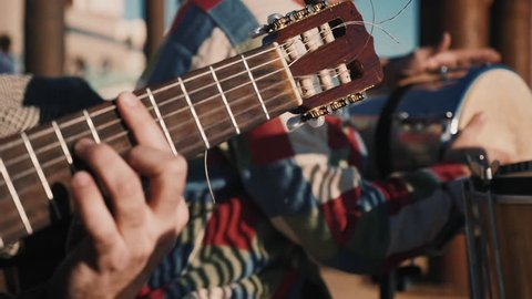 Traditional music street performer, playing music on a Musical Festival in the summer. 4K