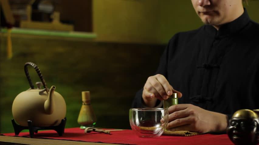 A man prepares tea according to a traditional recipe | Shutterstock HD Video #1024871552