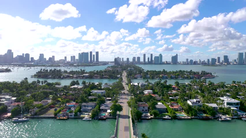 MIAMI, FLORIDA, USA - JANUARY 2019: Aerial drone panorama view flight over Miami. Venetian Islands and Biscayne Bay. Streets, hotels and residential buildings from above. | Shutterstock HD Video #1024897622