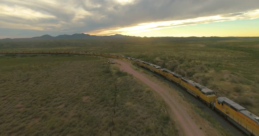 Drone approaching trains being parked along a railroad in Arizona, America.   Shutterstock HD Video #1024915082
