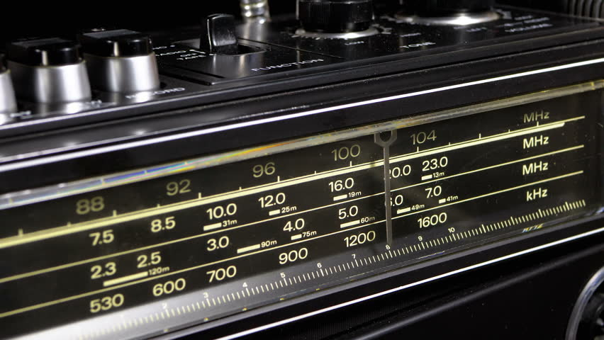 Tuning Analog Radio Dial Frequency on Scale of the Vintage Receiver. The frequency label moves in the range 90-108 MHz, and also over long, medium and short waves. Close-up. Radio frequency receiver | Shutterstock HD Video #1024916972