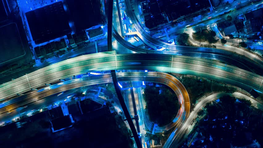 Hyper Time Lapse of Aerial View of Busy Highway Road Junctions at Night from a drone. The Intersecting Freeway Road Overpass The Eastern Outer Ring Road. | Shutterstock HD Video #1025109122