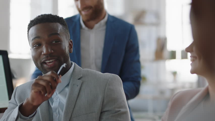Young african american businessman celebrating with team in office meeting clapping hands enjoying applause for brainstorming solution sharing victory | Shutterstock HD Video #1025151932