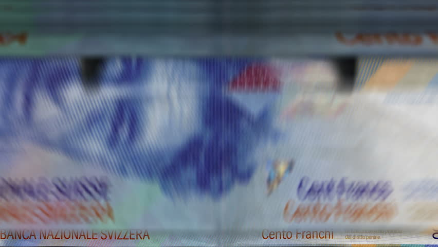 Money counting machine with 100 Swiss franc banknotes. Quick CHF currency down rotation. Business and economy concept loopable and seamless animation.   Shutterstock HD Video #1025184782