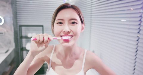 pretty woman brush her healthy teeth happily