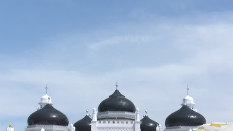 Baiturrahman Grand Mosque is a Mosque located in the center of Banda Aceh city, Aceh Province, Indonesia. The mosque is a landmark of Banda Aceh and has survived the 2004 Indian Ocean tsunami.