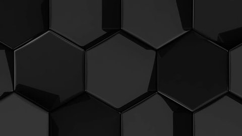 Black glossy animated moving hexagons with rounded edges. High quality seamless realistic video animation.
