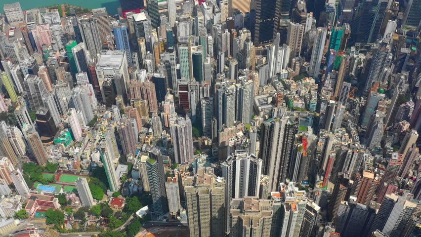 Sunny hong kong city downtown wan chai district high aerial topdown panorama 4k   Shutterstock HD Video #1025296352