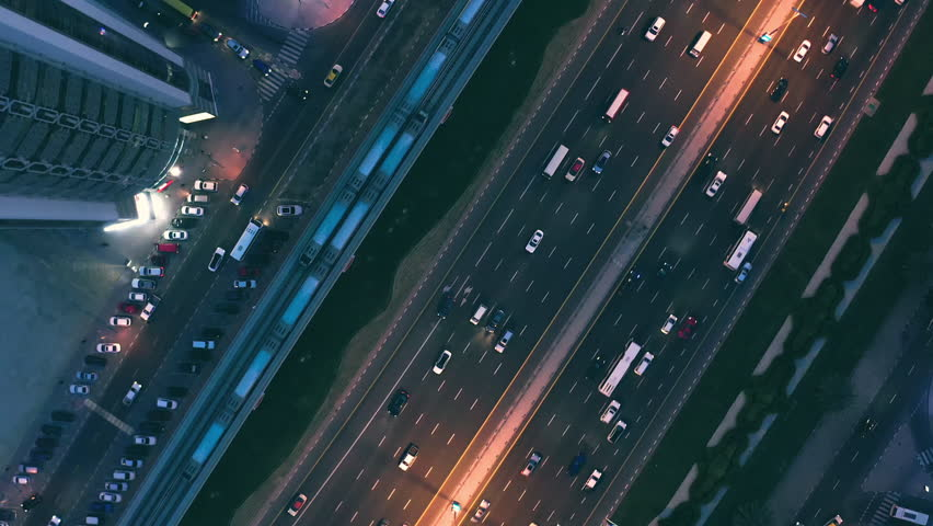 Aerial Flight Over Urban Traffic Cars Lights Moving Haighway Busy City Transport Dubai Business District Low Light Uhd Hdr 4k | Shutterstock HD Video #1025330462
