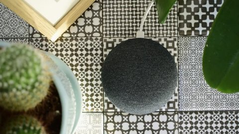 Athens, Greece - March 7 2019: Google home mini smart speaker with built in Google Assistant