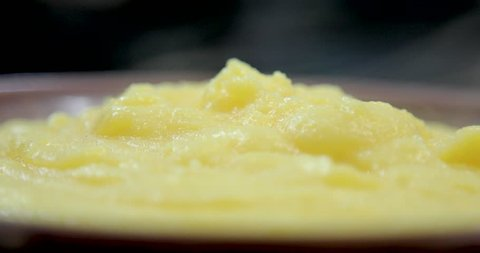delicious hot polenta dropping smoke on the plate