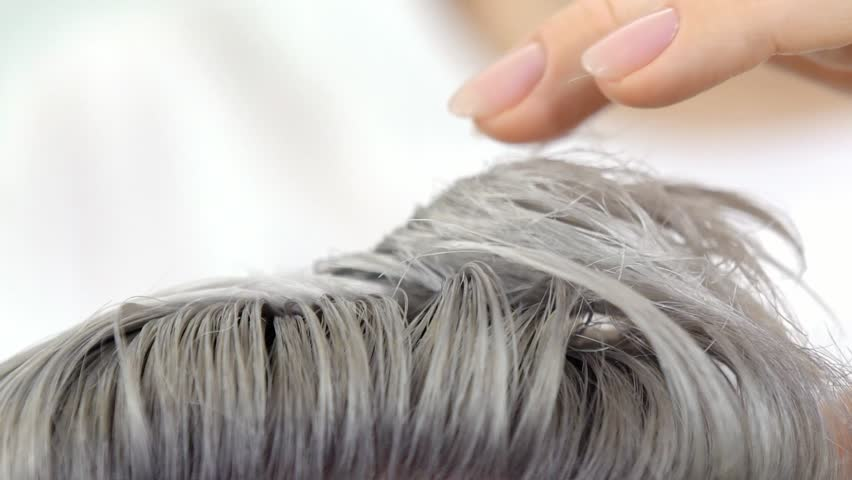 Demonstration of Result hair painting slow motion Close up shot, shows with fingers | Shutterstock HD Video #1025417912