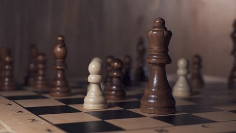 Chess game. White pawn beats black queen. Brain challenge, success, personal growth concept