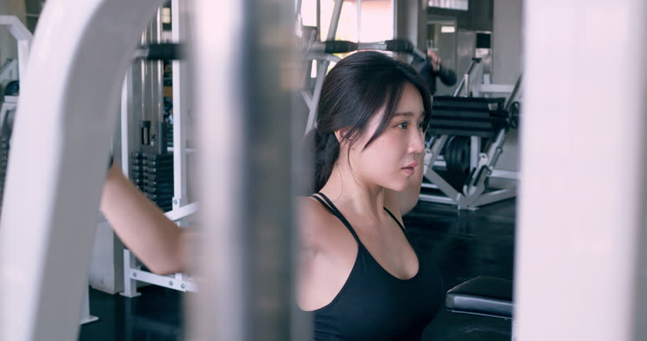 Asian beautiful woman training at the gym working out. Healthcare, Exercise and Sport concept. | Shutterstock HD Video #1025445152