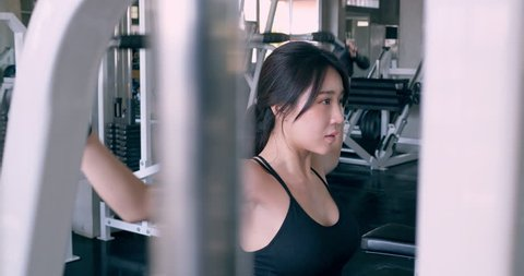 Asian beautiful woman training at the gym working out. Healthcare, Exercise and Sport concept.