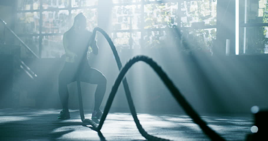 Attractive Muscular Female Battling Rope Workout At The Gym Functional Training Motivation Crossfit Focus Success Concept 4k | Shutterstock HD Video #1025504312