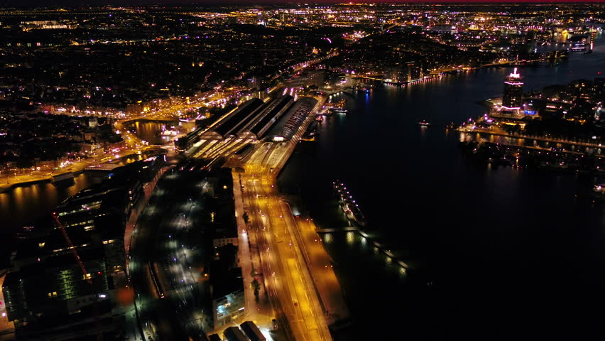 Aerial Netherlands Amsterdam June 2018 Night 30mm 4K Inspire 2 Prores  Aerial video of central Amsterdam in the Netherlands at night. | Shutterstock HD Video #1025568512