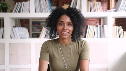 Smiling african american young woman student online teacher looking at camera webcam making video call to distant friend or job interview, happy mixed race blogger talking at webcamera recording vlog