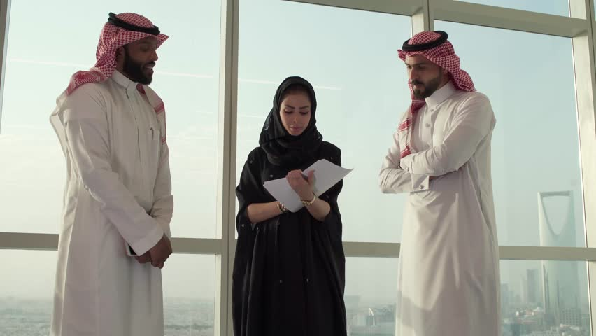 A Saudi woman wears abaya, Meeting at Saudi Arabia Company, Gulf job | Shutterstock HD Video #1025673602