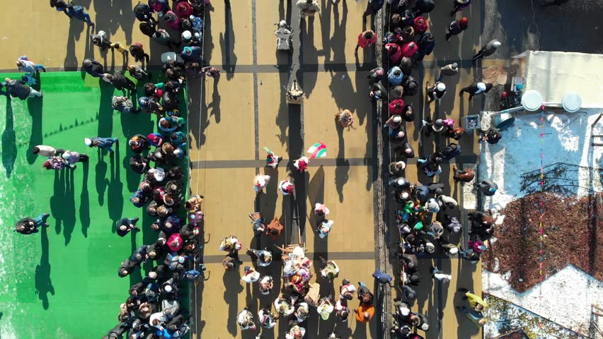 BULGARIA - JANUARY 27, 2019 - Aerial view of Surva masquerade festival street in Pernik, Bulgaria. Kukeri - people dressed in costumes and masks dance to scare the evil spirits. | Shutterstock HD Video #1025674712