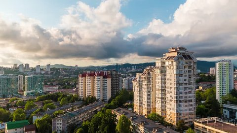 Time-lapse video of day to night transition with zooming and panoramic movement from right to left. Aerial view of the apartment district of the city of Sochi, Russia