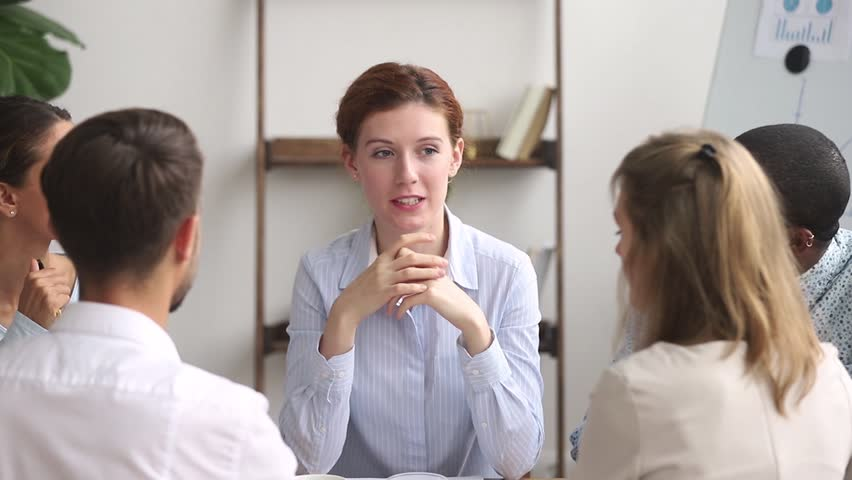 Female teacher coach mentor leader speaking teaching diverse staff students interns at group office meeting, executive manager speaker training employees consulting clients at team corporate workshop | Shutterstock HD Video #1025766332