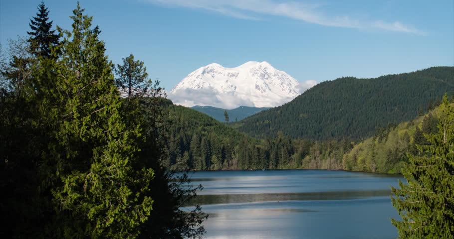Mount Rainier Snowy Mountain Peak Above Lake Timelapse Pacific Northwest Washington State Sunny Day