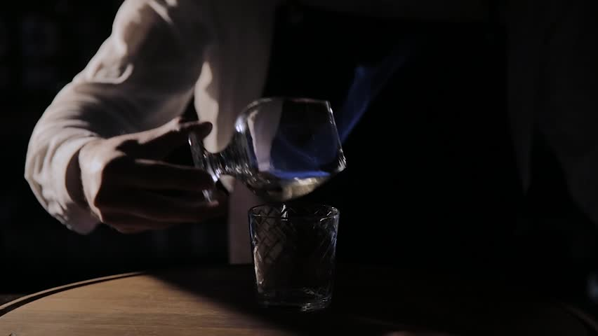 The process of preparing an alcoholic cocktail at the bar. | Shutterstock HD Video #1025829872