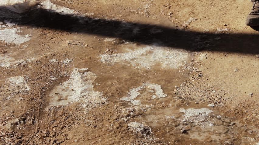 Man Walking Over Salty Dry Soil.   Shutterstock HD Video #1025866562
