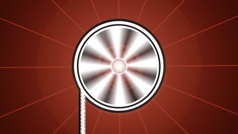 Graphic: Movie reel or spool spins until finished. Projection light at center.