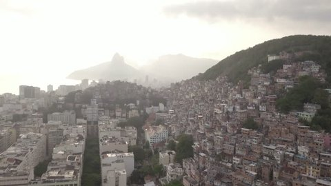 Drone shot tilting down to reveal favelas and building in Rio De Janeiro, Brazil.