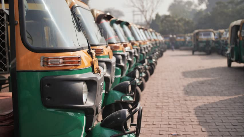 Indian taxi rickshaws exposed in a row. | Shutterstock HD Video #1025891612