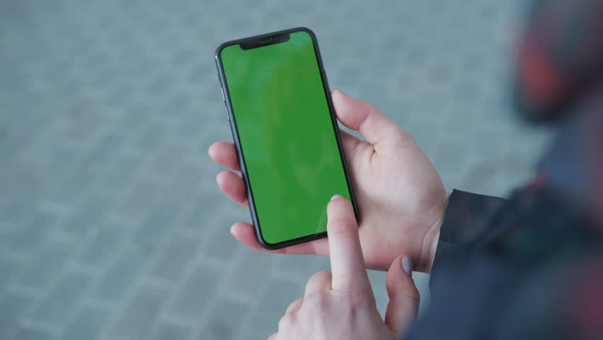 NEW YORK - April 5, 2018: Hands woman holding use touch phone with green screen on busy street background scrolling pages swiping surfing internet technology smartphone chroma key message slow motion | Shutterstock HD Video #1025899502