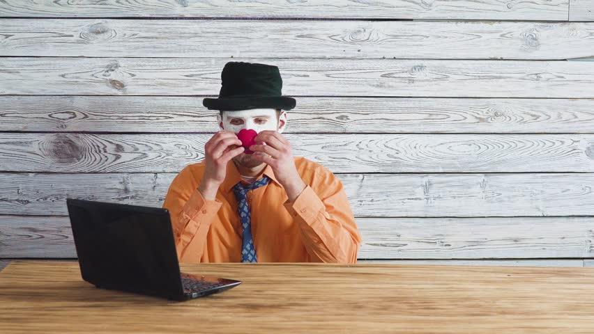 Office worker clown, clown concept at work. Businessman at the computer, work on a laptop. | Shutterstock HD Video #1025926682
