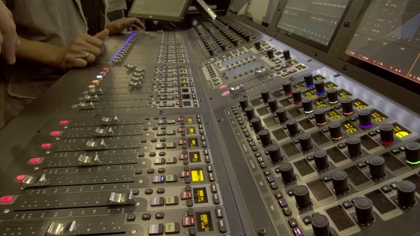 Handheld Shot of Sound Engineer Teaching Digital Audio Mixing Equipment 4K.MOV | Shutterstock HD Video #1025958152