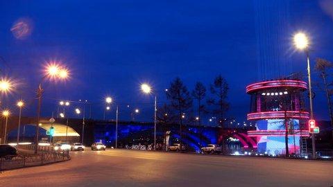 embankment overlooking the bridge at night, traffic, timelapse
